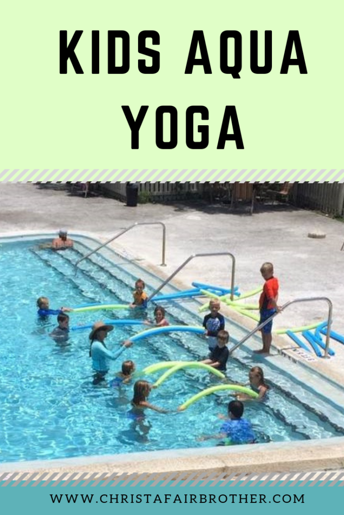 kids in the pool doing aqua yoga