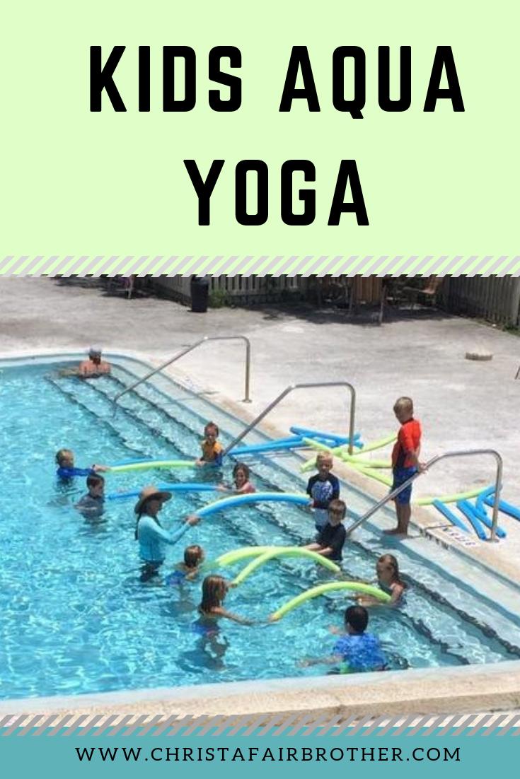 kids in the pool doing aqua yoga