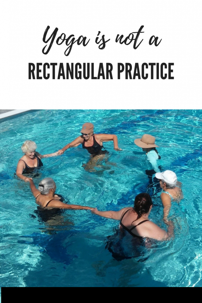 women holding hands in a circle in the pool to show yoga is not a rectangular practice