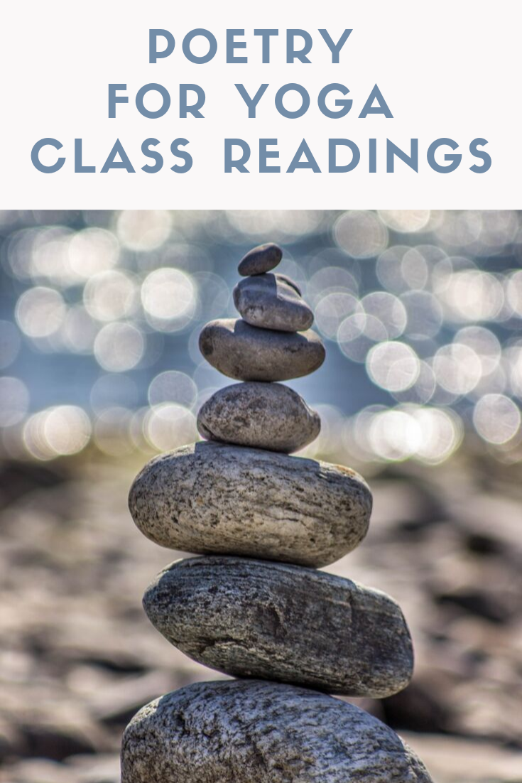 image of rocks balanced on top of each other on a beach to illustrate yoga poetry for class readings