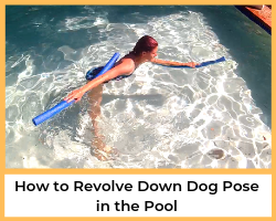 woman revolving down dog pose in the pool with two pool noodles