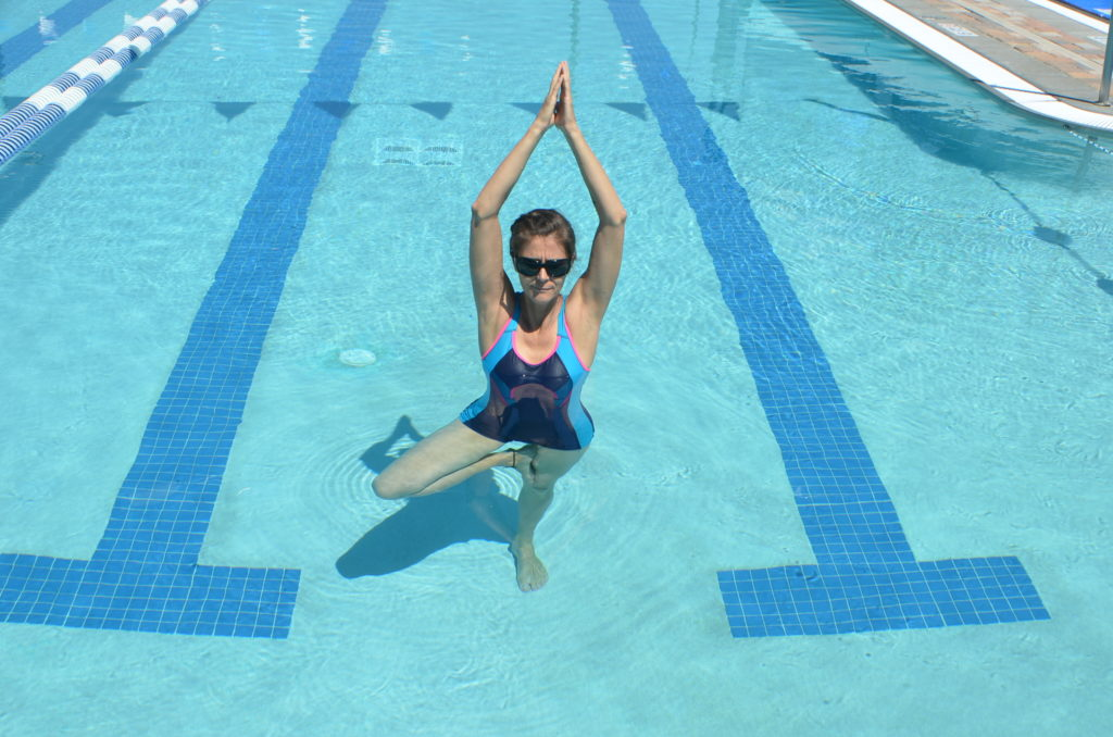 christa fairbrother doing tree pose in the pool