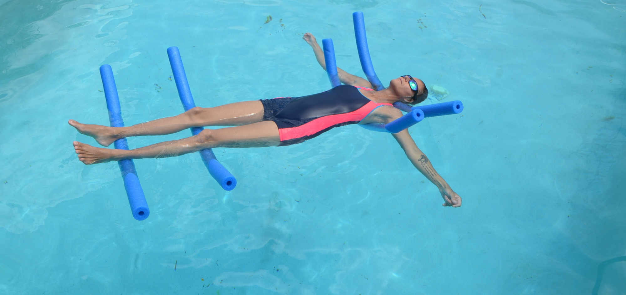 christa fairbrother doing aqua yoga in the pool