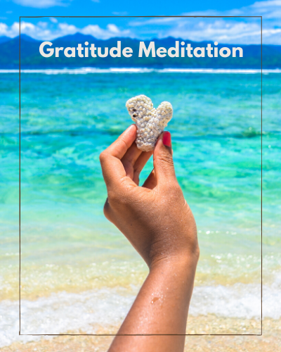 woman holding a heart shaped shell to announce the free audio download for a gratitude meditation