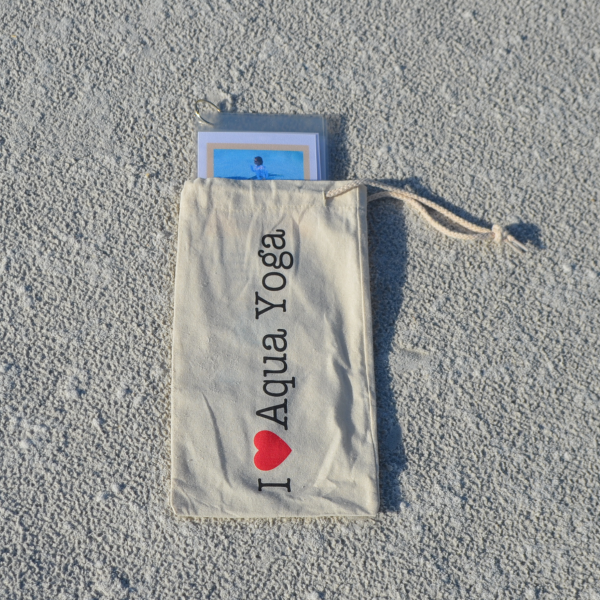 cotton aqua yoga bag shown on the sand