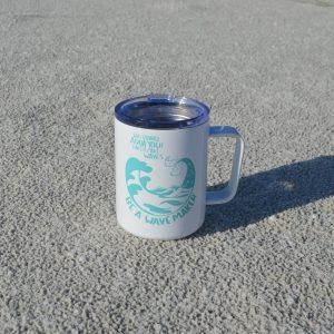 stainless steel aqua yoga tea mug in the sand