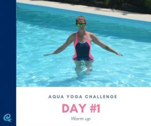 Woman walking in the pool to show one way to warm up as part of the aqua yoga challenge